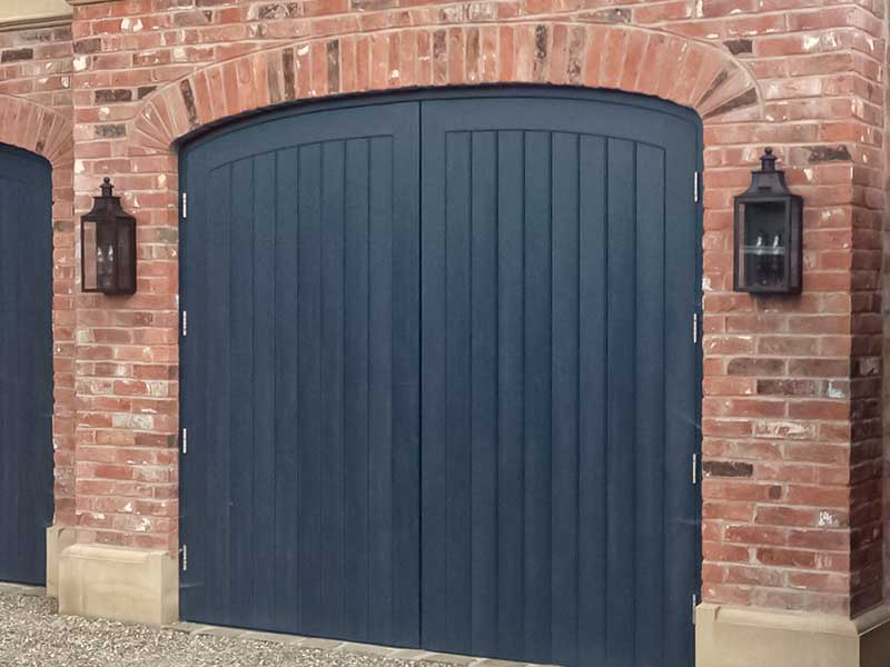 Dark Grey Wood Swing Garage Doors