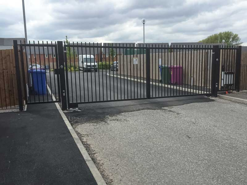 Double Vehicle Gates with Pedestrian Gate Bar Infill