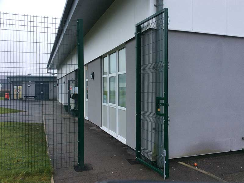 Exempla fencing with matching pedestrian gate