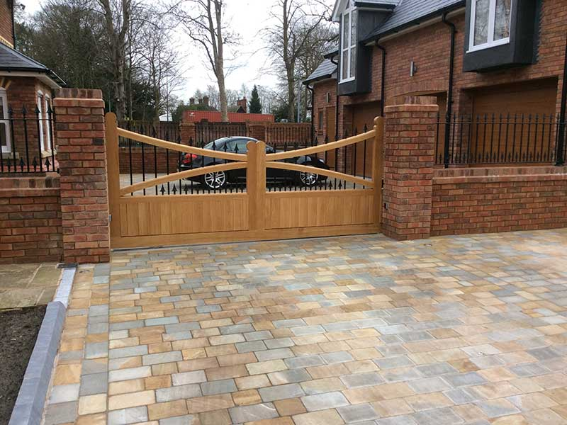 Wooden Sliding Gate with Wrought Iron Bars and Railings