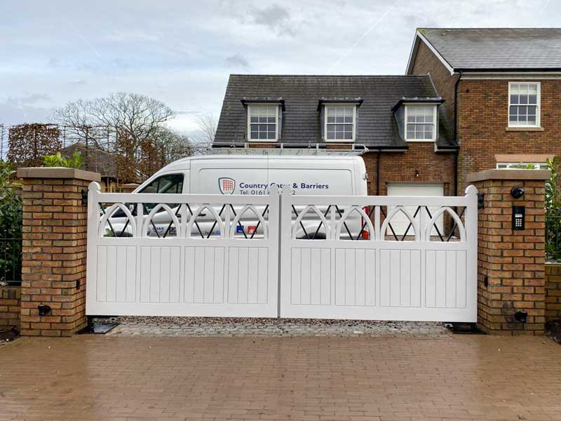 Accoya Swing Gates with cathedral arches and metal bar inserts